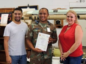 Mr Angelo Buckley, Researcher CRSES, University of Stellenbosch, Sgt Byron Johnson, Plumber, South African National Defence Force and Dr Karen Surridge, RECORD centre manager, SANEDI at the certificate handover